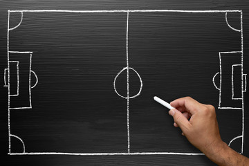 Hand drawing football tactic plan on Blackboard with chalk doodle