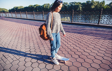 Beautiful Asian girl of 15-16 years old, millenial teenager on skateboard, entertainment and schoolgirl rest