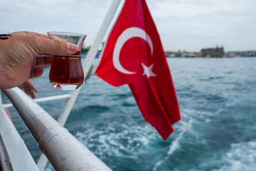 Turkish tea and flag on a boat in Istanbul, Turkey.