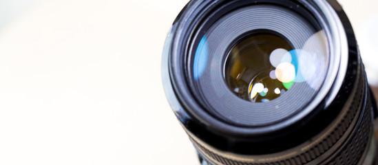 Camera lens with bokeh lights background, banner for website