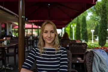 Blone girl in cafe in Istanbul, Turkey.