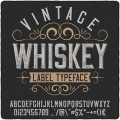 "Vintage western label font named ""Whiskey"". Good typeface for any retro design like poster, t-shirt, label, logo etc."