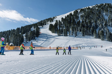 Dolomites, ski area with beautiful slopes. Empty ski slope in winter on a sunny day. Prepared piste and sunny day