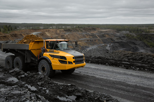 Articulated dump truck on the road in an open coal mine.