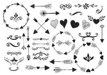 Set of vector flourishes. Hand drawn hearts, arrows, dividers and vines.