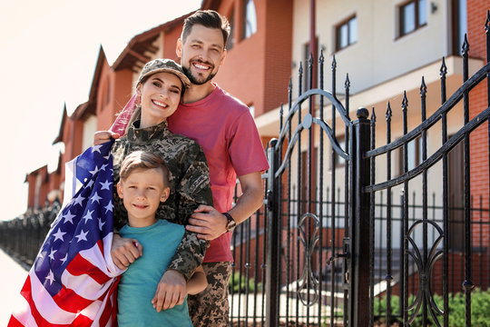 American soldier with her family outdoors. Military service