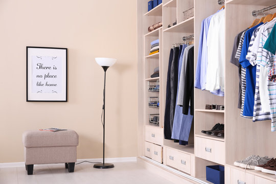 Room interior with wardrobe and stylish ottoman chair