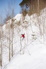 Image of man riding snowboard