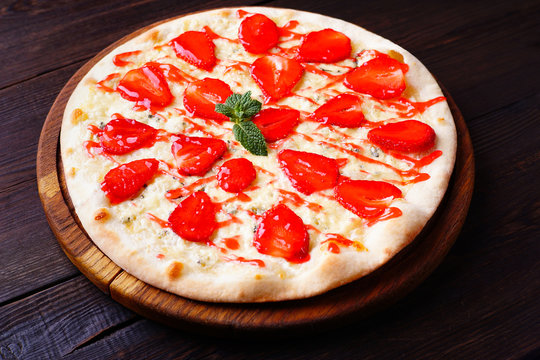 Original summer snack, strawberry pizza close up. Seasonal sweet pastry, food delivery, restaurant, pizzeria menu concept