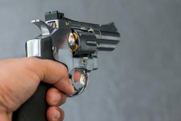 Man holding gun revolver pistol in shooting