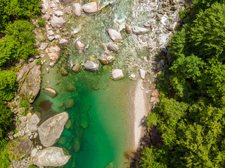 Valle Verzasca - Aerial View of clear and turquoise water stream and rocks in Verzasca River in Ticino - Verzasca Valley in Tessin, Switzerland