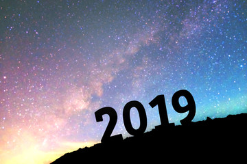 Silhouette  Happy for 2019 new year background on  the Milky Way galaxy