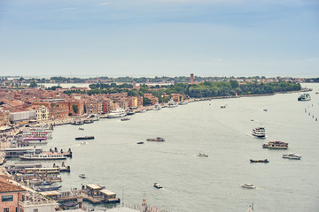 "Panoramic view of Venice in Italy / Promenade ""Riva degli Schiavoni"" with jetties and bridges -  Close to the Doges Palace"