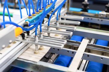 Pneumatic paper feeder. Modern printing machine