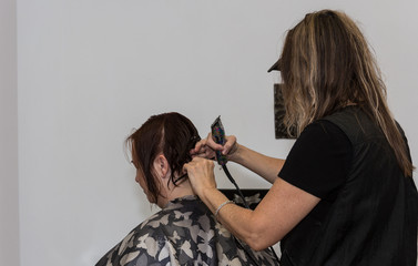 Beautiful Redhead Getting Her Hair Styled