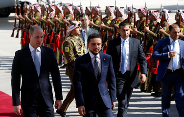 Britain's Prince William and Jordan's Crown Prince Hussein bin Abdullah II review the honour guard in Amman