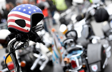 """A helmet, painted in the colors of the U.S. flag, is pictured in front of Harley-Davidson bikes at the """"Hamburg Harley Days"""" in Hamburg"""