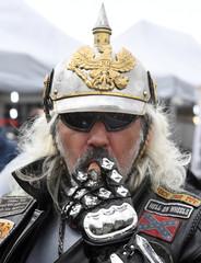 "A biker smokes a cigar at the ""Hamburg Harley Days"" in Hamburg"