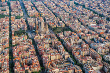 Aerial view of Barcelona Eixample residencial area and Sagrada familia, Spain. Late afternoon light