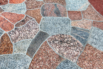 Surface of polished colored granite. Footpath, pavement of granite