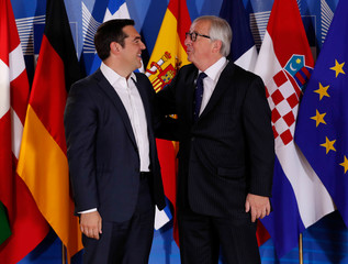 Greek Prime Minister Alexis Tsipras is welcomed by European Commission President Jean-Claude Juncker at the start of an emergency European Union leaders summit on immigration at the EU Commission headquarters in Brussels