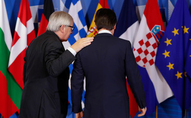 Italian Prime Minister Giuseppe Conte is welcomed by European Commission President Jean-Claude Juncker at the start of an emergency European Union leaders summit on immigration at the EU Commission headquarters in Brussels