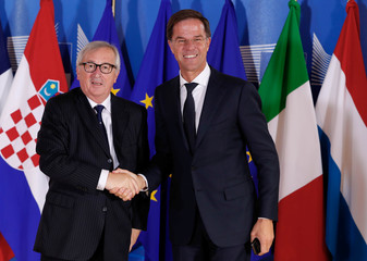 Dutch Prime Minister Mark Rutte is welcomed by European Commission President Jean-Claude Juncker at the start of an emergency European Union leaders summit on immigration at the EU Commission headquarters in Brussels