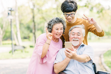 Seniors family having fun with smartphone