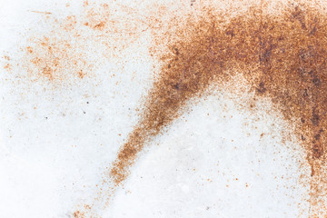 A close-up of rust on a white metal plate. Abstract background texture Wall mural