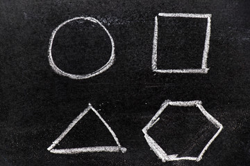 CHalk hand drawing as geometric shape (Circle, triangle, square, hexagon) on black board background