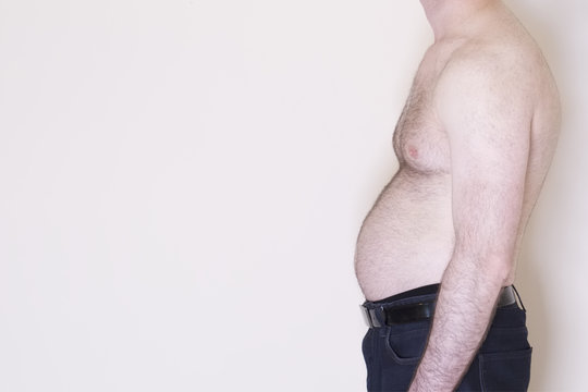 Middle age spread overweight beer belly tummy male man health unhealthy lifestyle obesity weight stomach