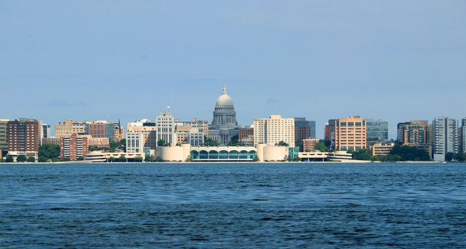 City skyline and architecture background.Cloudy blue sky over downtown with capitol state building and Monona terrace.Summer view across the lake Monona. City of Madison, the capital of Wisconsin, USA