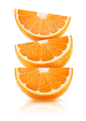 Three wedges of orange fruit on top of each other isolated on white background with clipping path