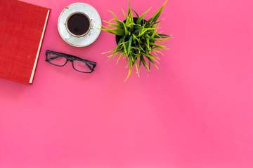 Reading for study and work. Self-education concept. business literature. Books with empty cover near glasses, coffe, plant on pink desk top view copy space