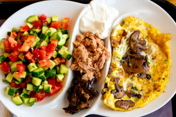 A delicious tradition Mediterranean breakfast in the port of Tel-Aviv, Israel. Selective focus.