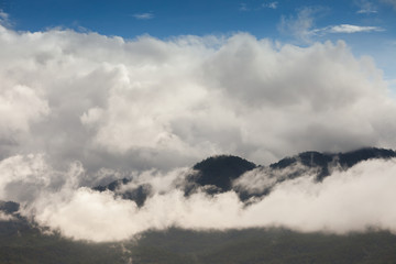 Landscape view of mountain with foggy under clear sky located at tropicana south east Asia.