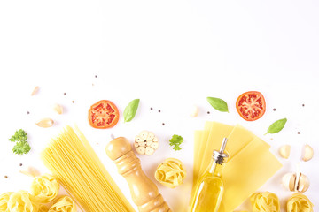 Food and drink concept - various uncooked pasta with ingredients for cooking