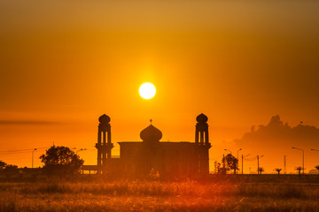 Beautiful mosque under colorful of sunrise
