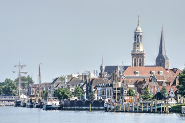 View across the river IJssel towards the riverfront of the old Hanze town of Kampen, The Netherlands Fototapete
