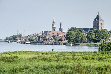 View across the river IJssel and its floodplain towards the old Hanze city of Kampen, The Netherlands Fototapete
