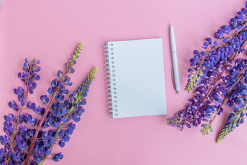 Mockup notebook with lupine flower