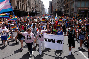 Democratic candidate for New York Governor Cynthia Nixon marches with her wife Christine Marinoni in the 2018 New York City Pride Parade in Manhattan, New York
