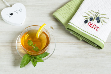 Cup of herbal linden tea on white background