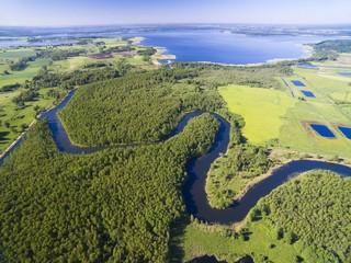 Foto op Aluminium Rivier Meander of Wegorapa river flowing across wetlands, Mazury, Poland. Mamry Lake in the background