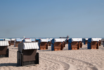 Closed beach chair huts on white sand beach in Warnemunde Germany
