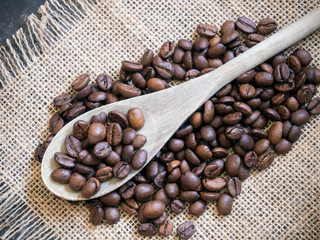 coffee beans background with wooden spoon
