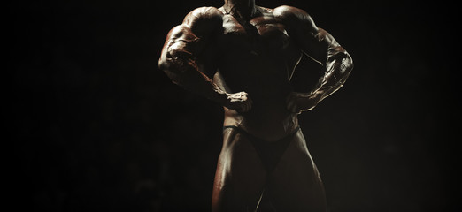 athlete bodybuilder posing most muscular bodybuilding competitions