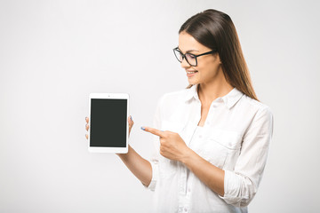 Portrait of a beautiful woman using tablet computer isolated on a white background. Free space for text.