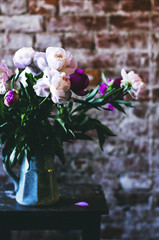 Bunch of peonies in a blue vase