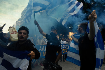 Protesters holding Greek flags shout slogans during a demonstration against the agreement reached by Greece and Macedonia to resolve a dispute over the former Yugoslav republic's name, in Thessaloniki
